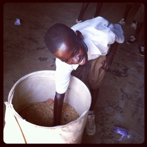A-pupil-of-Kukua-RC-trying-his-luck-in-a-lucky-dip-after-a-clean-hands-save-life-quiz