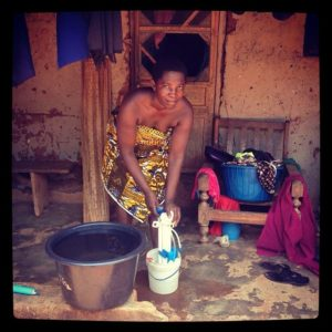 This-woman-and-children-living-with-her-can-now-drink-safe-water-because-of-this-water-purifier