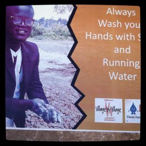 An-opinion-leader-at-Akorabo-advices-community-members-through-this-poster