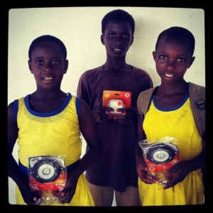 Three-students-from-Abenta-school-receive-solar-lights-to-help-them-do-homework-in-the-evening.-So-f
